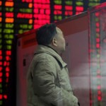 China's shares rise after PBOC rate cut