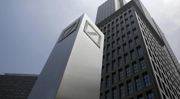 Logos of Deutsche Bank AG are seen in Tokyo