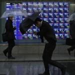 Asian markets trade mixed; Japan shares spike on BOJ