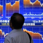 Asian shares sank on Friday; The dollar index against a basket of six major currencies was flat