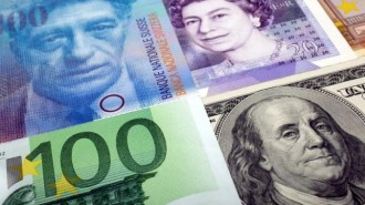 A picture illustration of U.S. dollar Swiss Franc British pound and Euro bank notes
