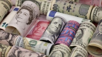 Euro, Hong Kong dollar, U.S. dollar, Japanese yen, British pound and Chinese 100-yuan banknotes are seen in a picture illustration