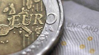 A two Euro coin is pictured next to an English ten Pound note in an illustration