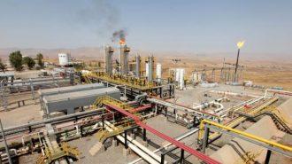 A flame rises from a chimney at Taq Taq oil field in Arbil