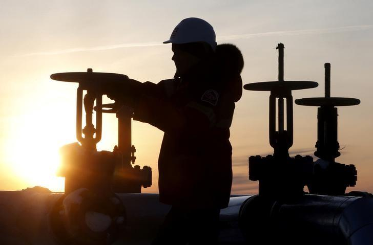 Oil Prices, A worker checks the valve of an oil pipe at Lukoil company owned Imilorskoye oil field outside the Siberian city of Kogalym