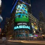 Dow, S&P end at records; Apple, Google drag on Nasdaq