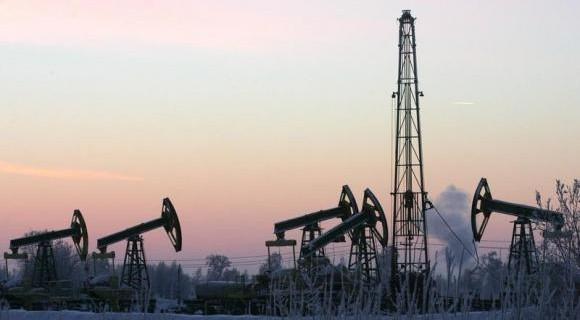 Derricks at Yuganskneftegaz oil processing facility at Mamontovskoye oilfield outside the Siberian ...