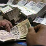 Modi at the helm, and the rupee falls