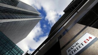 A sign for Bank Street and high rise offices are pictured in the financial district Canary Wharf in London