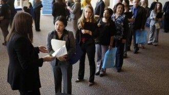 Jobseekers wait to talk to a recruiter at the Colorado Hospital Association's health care career event in Denver