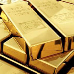 Gold settles lower; other metals slide