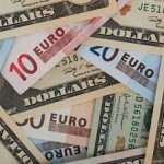 Dollar slips against commodity currencies; the euro was down against the pound