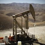 Oil prices fall on rise in U.S. drilling, strong dollar
