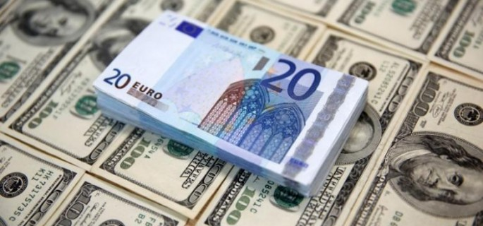 U.S. dollar and euro banknotes are seen in this picture illustration
