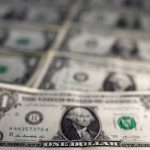 Dollar slips, euro edges up