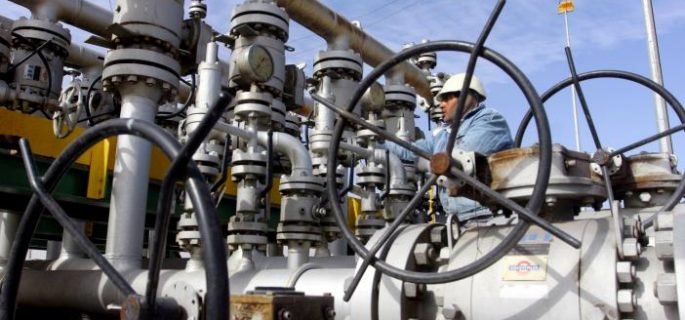A worker checks the valves at Al-Sheiba oil refinery in Basra