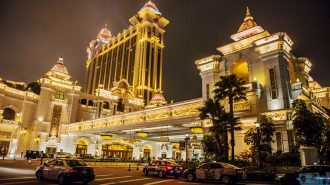 Taxis sit parked in front of the Galaxy Macau casino and hotel in Macau, China