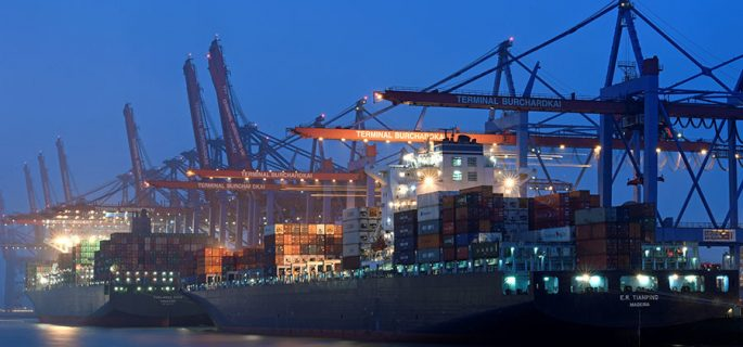 A containership at a loading terminal is seen in the port of Hamburg, Germany